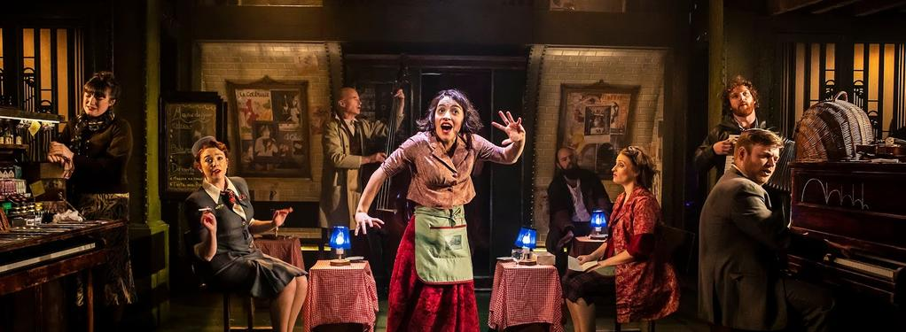 Photograph from Amélie - lighting design by Elliot Griggs