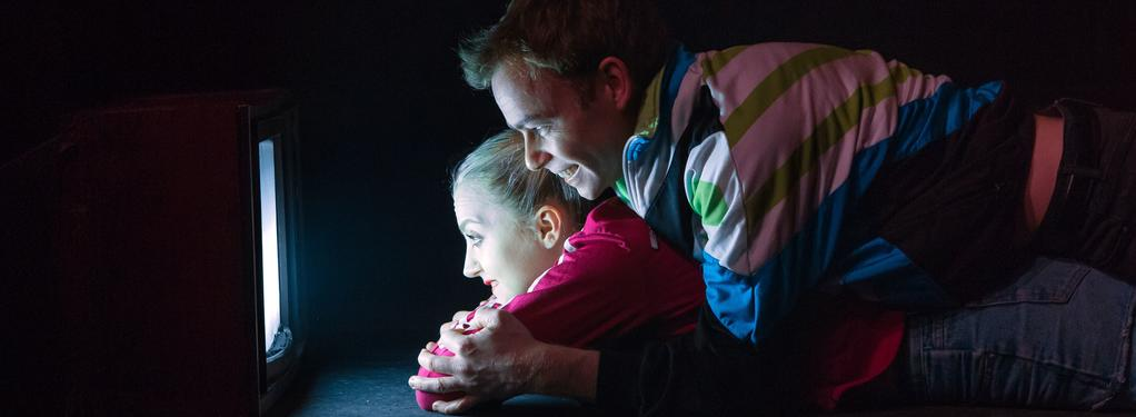 Photograph from Disco Pigs - lighting design by Elliot Griggs