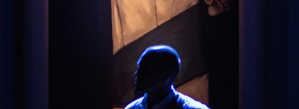 Photograph from Winston's Birthday - lighting design by HawkinsLX
