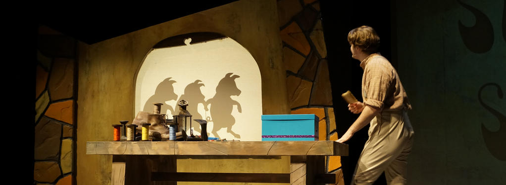 Photograph from Puss in Boots - lighting design by HawkinsLX