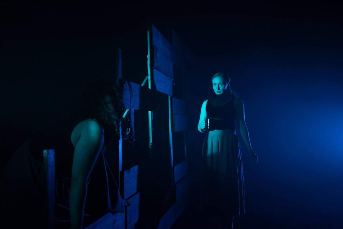 Photograph from We Like It Here - lighting design by Alan Mooney