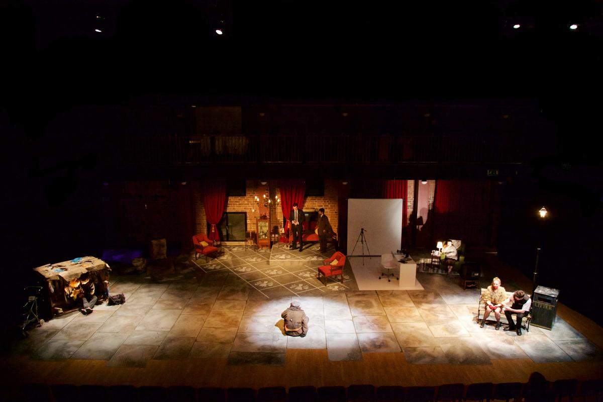 Photograph from The Strangeness of Others - lighting design by George Leigh