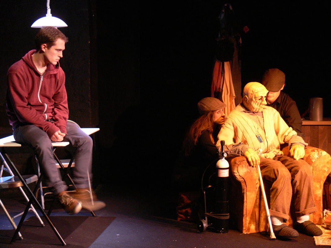 Photograph from Killing Roger - lighting design by Claire Childs