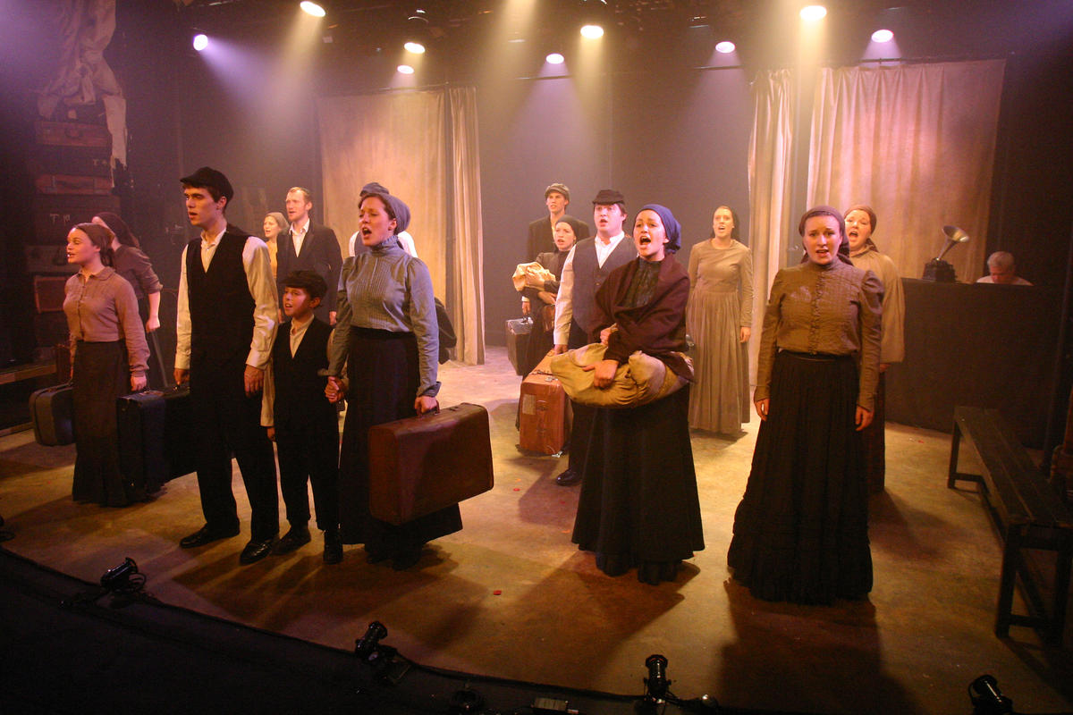 Photograph from Rags - lighting design by John Castle