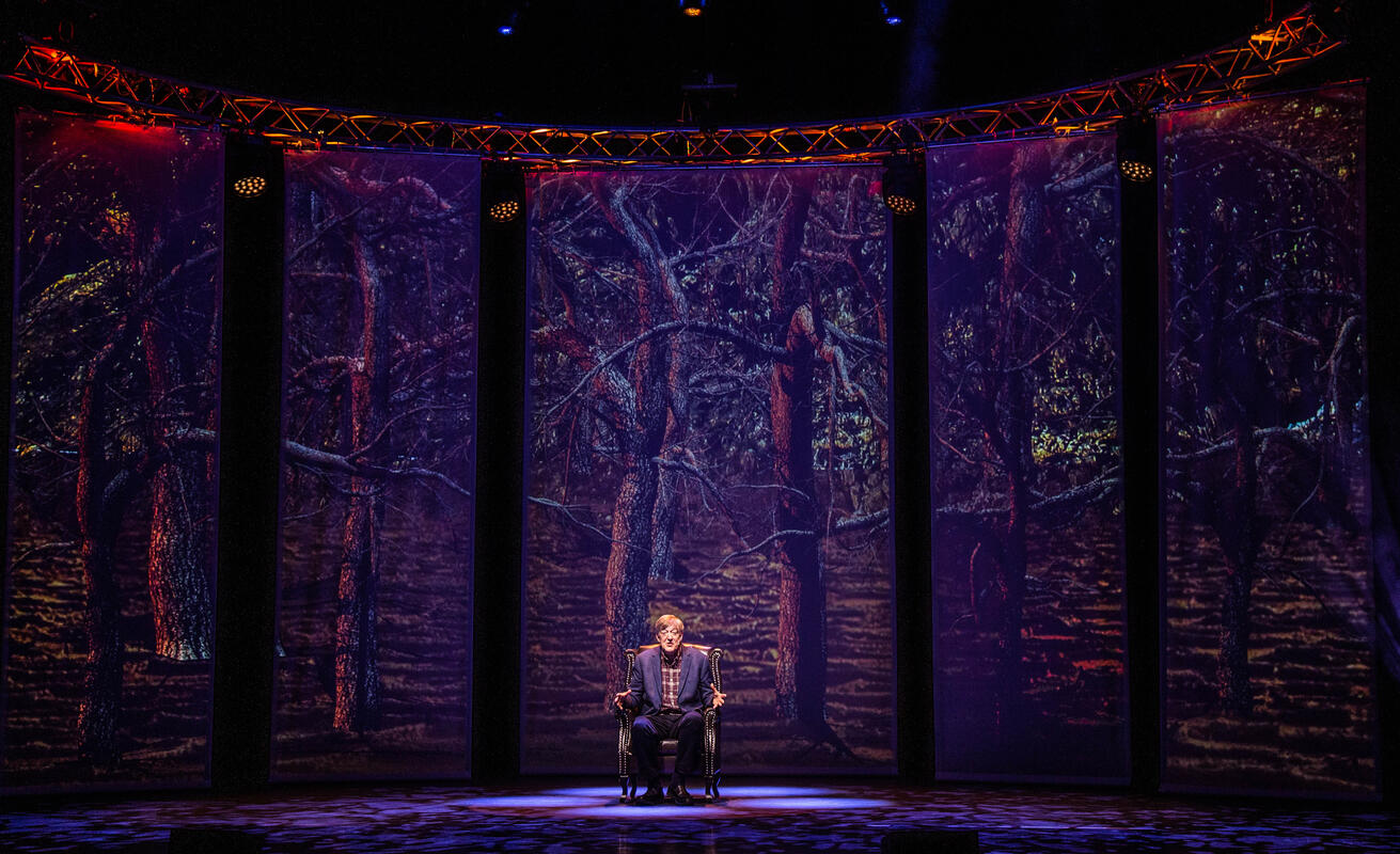 Photograph from Stephen Fry - Mythos Tour, A Trilogy Of A Shows - lighting design by Archer