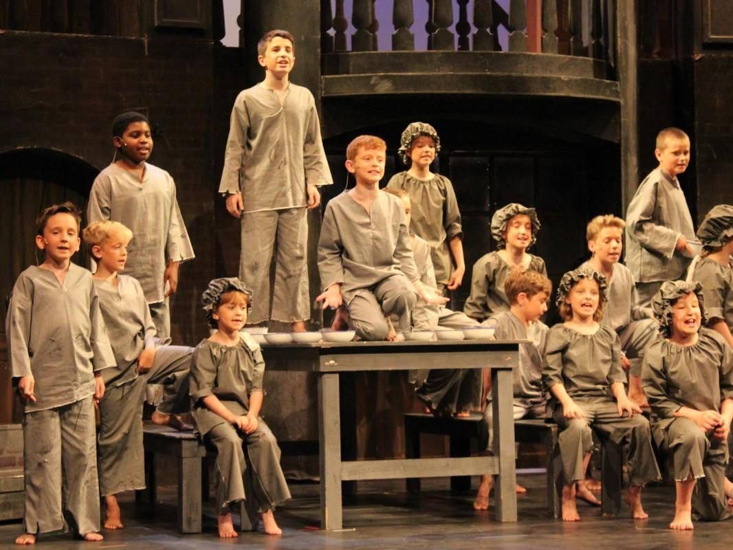 Photograph from Oliver - lighting design by Chris May