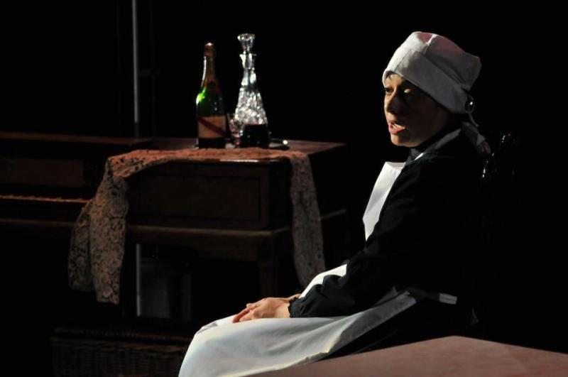 Photograph from Looking After The Pooters - lighting design by Ben Skipworth