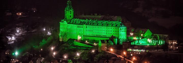 Heidecksburg Castle lit in green