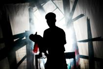 Photograph from Missing In Action - lighting design by Charlie Morgan Jones