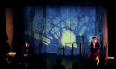 Photograph from Dancing with the Orange Dog - lighting design by Jason Salvin
