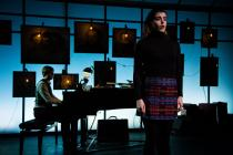 Photograph from Why Does The Queen Die? - lighting design by Charlie Morgan Jones