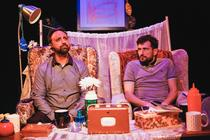 Photograph from Burkas and Bacon Butties - lighting design by Alex Lewer