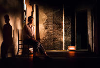 Photograph from Grey Man - lighting design by Jamie Platt