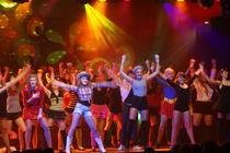 Photograph from Boogie Nights - lighting design by Pete Watts