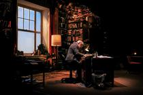 Photograph from Educating Rita - lighting design by Elliot Griggs