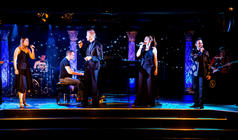 Photograph from An Evening With Sir Tim Rice - lighting design by Archer