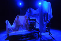 Photograph from I'm Afraid Of Amerikans - lighting design by Harry Owen