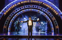 Photograph from The Magic Goes Wrong - lighting design by David Howe
