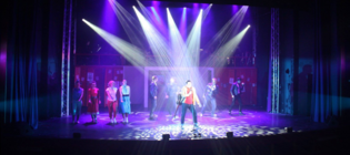 Photograph from Grease - lighting design by Seb Blaber