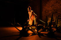 Photograph from 100 Years - lighting design by Claire Childs