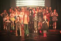 Photograph from We Will Rock You (School's Edition) - lighting design by Alex Cann